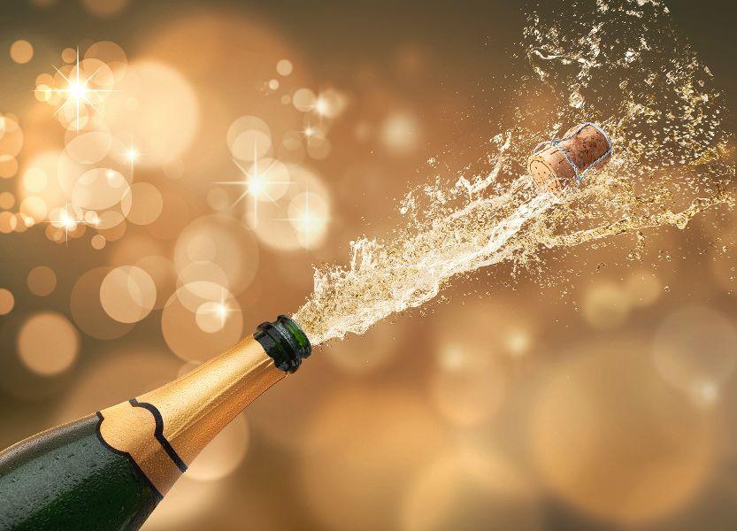 Champagner Korken knallen lassen